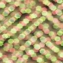 ネオンの光がキラキラと乱反射しているようなパターン